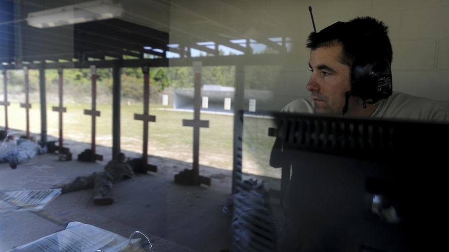Staff Sgt. Darrin Miller, a Combat Arms Training and Maintenance instructor with the 1st Special Operations Security Forces Squadron, observes the firing line during a rifle competition at Hurlburt Field, Fla., April 4, 2017. Miller ensured procedures and safety measures were enforced during the Excellence in Competition event. (U.S. Air Force photo by Airman 1st Class Dennis Spain)