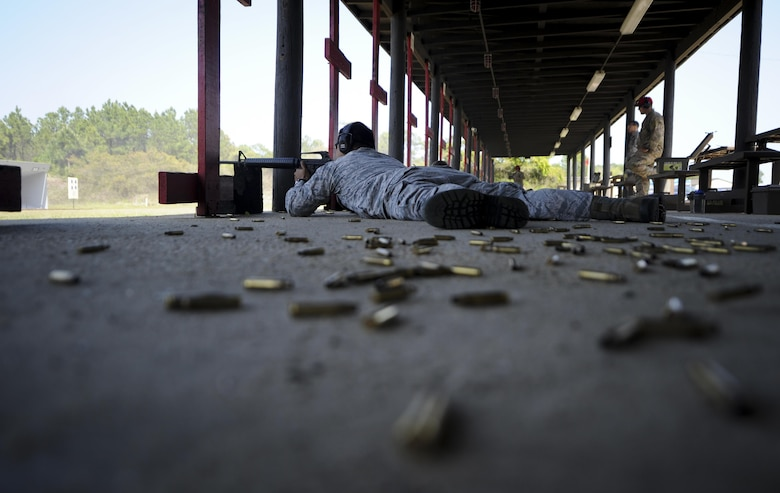 Airman 1st Class Christon Reed, a contracting specialist with the 1st Special Operations Contracting Squadron, aims a rifle down range at Hurlburt Field, Fla., April 4, 2017. The 1st Special Operations Security Forces Squadron hosted Excellence in Competition, a rifle competition in which the top 10 percent will be awarded an Excellence in Competition Rifleman Badge. (U.S. Air Force photo by Airman 1st Class Dennis Spain)