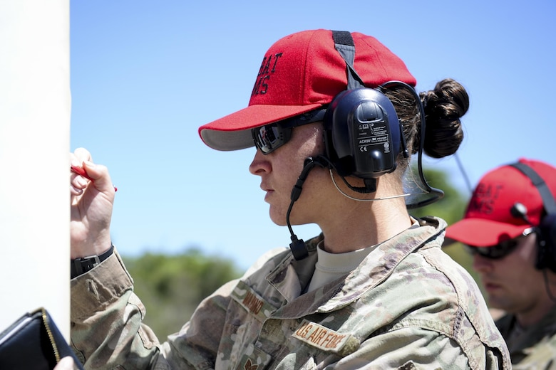 Staff Sgt. Elizabeth Marino, the NCO in charge of Combat Arms Training and Maintenance with the 1st Special Operations Security Forces Squadron, counts a shooter's score during a rifle competition at Hurlburt Field, Fla., March 6, 2017. The 1st SOSFS hosted the Excellence in Competition event in which the top 10 percent will be awarded an Excellence in Competition Rifleman Badge. (U.S. Air Force photo by Airman 1st Class Dennis Spain)