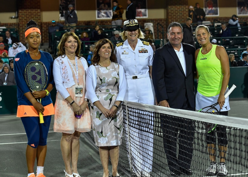 U.S. Navy Capt. Elizabeth Maley, Naval Health Clinic Charleston commander, poses for a photo after performing a coin toss during military appreciation night at the Volvo Car Open tennis tournament, April 6, 2017. Maley, U.S. Air Force Master Sgt. Toby Housey, 315th Airlift Wing Equal Opportunity superintendent, and the Joint Base Charleston Honor Guard represented JB Charleston by participating in the coin toss, singing of the national anthem and posting of colors.