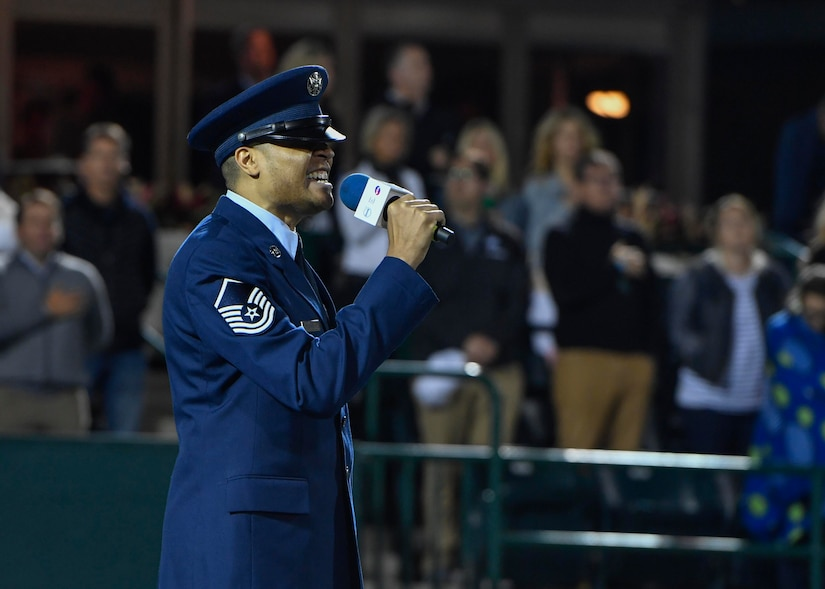 U.S. Air Force Master Sgt. Toby Housey, 315th Airlift Wing Equal opportunity superintendent, sings the national anthem during military appreciation night at the Volvo Car Stadium, April 6, 2017. Housey, U.S. Navy Capt. Elizabeth Maley, Naval health Clinic Charleston commander, and the Joint Base Charleston Honor Guard represented JB Charleston with the coin toss, singing of the national anthem and posting of colors.