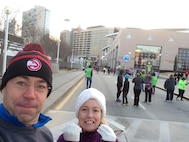 Master Sgt. Mike R. Smith, assigned to the I.G. Brown Training and Education Center, and his wife, Marva, line up for the Atlanta Hawks Fast Break 5K outside Phillips Arena in downtown Atlanta, Feb. 4, 2017. (U.S. Air National Guard photo by Master Sgt. Mike R. Smith)