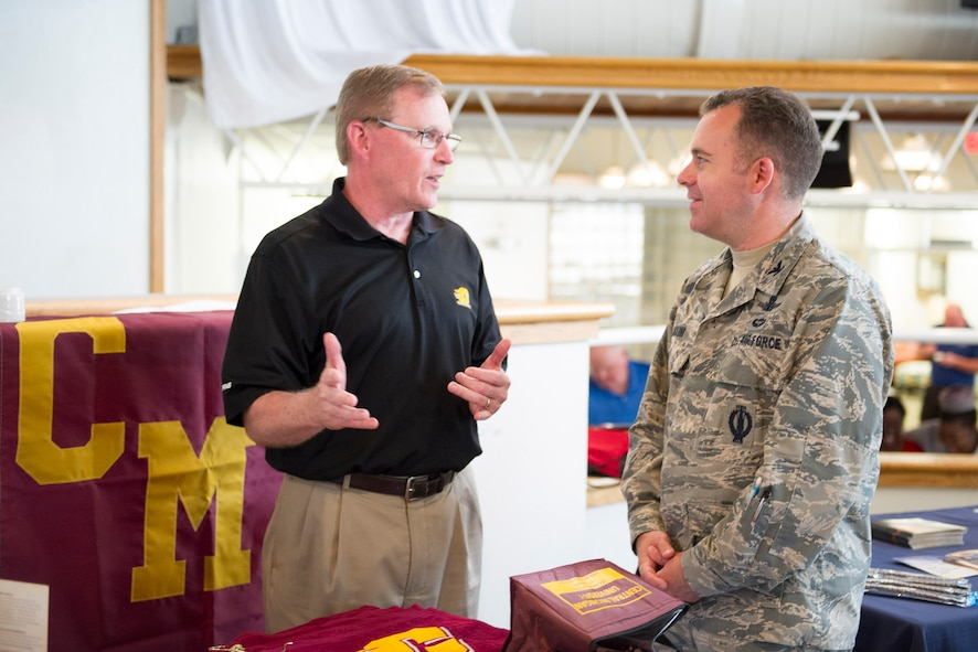 Col. Walt Jackim, 45th Space Wing vice commander, engages in conversation with an educational representative from Central Michigan University during an Education Fair at Patrick Air Force Base, Fla. April 4, 2017. Whether Airmen are at the beginning of their journey or planning to continue on, the event was a step in the right direction for those seeking higher education. (U.S. Air Force photo by Derwin Oviedo)