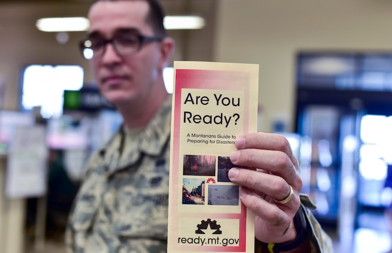 Airman 1st Class Ismael Zayas Ramos, 341st Civil Engineer Squadron readiness and emergency management flight apprentice, shares a preparedness pamphlet April 11, 2017, at Malmstrom Air Force Base, Mont. As part of this year's America's PrepareAthon!, held every spring and fall, the emergency management flight is hosting different events around base to help spread awareness and ensure Airmen and their families are ready for any disaster Montana may throw at them. (U.S. Air Force photo/Master Sgt. Chad Thompson)