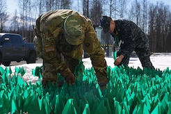 Joint Base Elmendorf-Richardson service members and personnel participate in the Teal Flag Project at the JBER Commissary, Alaska, April 11, 2017. The Teal Flag Project is a silent exhibit illustrating the number of sexual assaults in a given fiscal year. Each of the 3,828 flags planted represent a survivor who reported a sexual assault through the Sexual Assault Prevention and Response Office and the Sexual Harassment and Assault Response Prevention programs across the Air Force and Army departments during fiscal year 2015.
