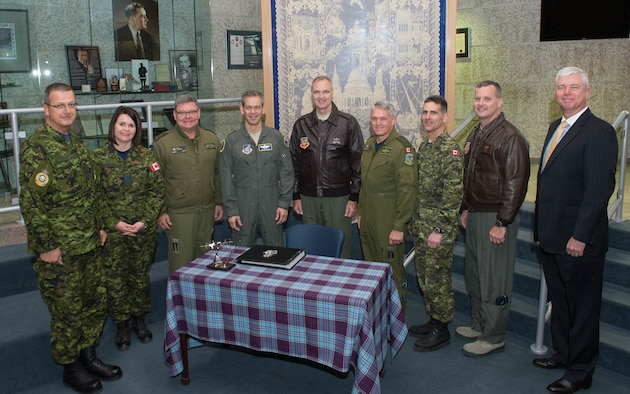 Commanders from across the North American Defense Command enterprise met April 11 at 1 Canadian Division Headquarters, 17 Wing, in Winnipeg, Manitoba, Canada to discuss their mutual mission requirements. Here, gathered around the headquarters guest book are: (L-R) 1 CAD Chief Warrant Official Serge Laforge; Lt Col Marcy Spiers, 1 CAD HQ Commanding Officer; Brig Gen Paul Ormsby, Deputy Commander, Continental U.S. North American Aerospace Defense Command Region; Lt.  Gen. Kenneth Wilsbach, Commander, Alaskan NORAD Region; Lt. Gen. R. Scott Williams, Commander, CONR-1st Air Force (Air Forces Northern); Maj Gen Christian Druin, 1 CAD Commander; 1 CAD CWO Michael Scarcella; Brig. Gen. Dan Orcutt, Vice Commander, 1st Air Force (Air Forces Northern)  and Van Wimmer, CONR-1AF(AFNORTH) liaison officer to NORAD-U.S. Northern Command. (Photo by Cpl Justin Ancelin, 17 Wing Imaging)