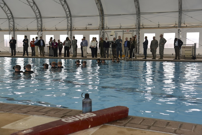 Charleston civic leaders and Joint Base Charleston leadership watch as Airmen train with the 342th Training Squadron in underwater scenarios as part of the Battlefield Airman entry-level course, March 16, 2017. The 342nd TRS's mission is to prepare pararescue, combat control, special operations weather, and Tactical Air Control Party Airmen to thrive in uncertain environments around the world.