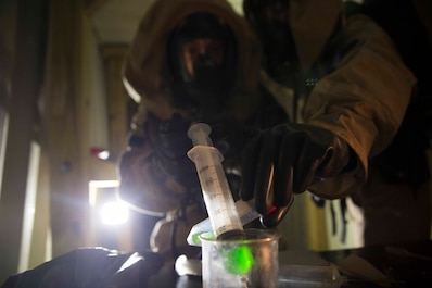 TUNNEL HILL, Ga. - Cpl. Phillip Butler and Sgt. Elliot Homan, hazmat technicians with Chemical Biological Radiological Nuclear Platoon, Combat Logistics Regiment 4, 4th Marine Logistics Group, Marine Forces Reserve, document and sample an unknown substance during a CBRN training exercise at Volunteer Training Site, Catoosa, Tunnel Hill, Ga., April 6, 2017. The assessment and consequence management team conducted their quarterly ACM training to enhance their CBRN capabilities. The training focused on specialized identification, sampling and the collecting of CBRN materials as well as simulated weapons of mass destruction. (U.S. Marine Corps photo by Cpl. Devan Alonzo Barnett/Released)