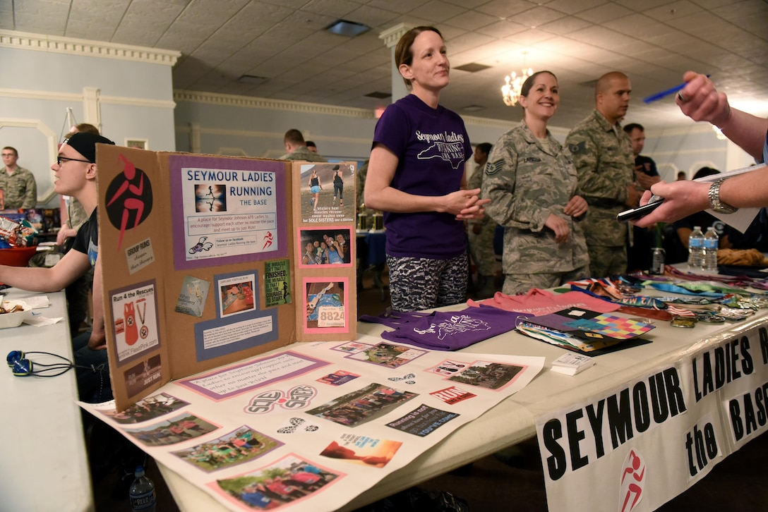 Senior Master Sgt. Kiera Daniels, 4th Medical Group first sergeant, and Tech. Sgt. Christina Lariccia, 4th Medical Support Squadron pharmacy technician, represent the Seymour Ladies Running club at MIBCON17, March 31, 2017, at Seymour Johnson Air Force Base, North Carolina. MIBCON17 showcased the base's Make It Better initiative to create interactive events for Airmen and their families to participate in and increase morale. (U.S. Air Force photo by Airman 1st Class Kenneth Boyton)