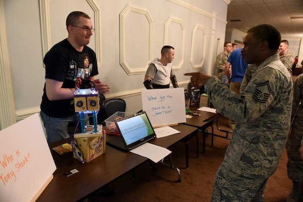Tech. Sgt. Samuel Finch, 4th Component Maintenance Squadron support section NCO in charge (left), represents the Trivia club and quizzes Senior Master Sgt. Donald Winchester, 4th Civil Engineer Squadron superintendent (right), during MIBCON17, March 31, 2017, at Seymour Johnson Air Force Base, North Carolina. More than 40 clubs were on display for Airmen and their families to gain more information and possibly join. (U.S. Air Force photo by Airman 1st Class Kenneth Boyton)