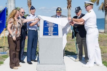 Debbie Wilson, daughter of Joh Myhre; Rep. Bill Posey, 8th District of Florida; Brig. Gen. Wayne Monteith, 45th Space Wing commander; Retired Navy Rear Admiral Samuel Cox, Naval history and heritage command director and curator; Retired Army Capt. Jon Myhre, Naval Air Station Fort Lauderdale historical association and museum member; and Capt. John Sager, Naval Ordnance Test Unit commander, unveil the Banana River Naval Air Station Monument during a ceremony April 11, 2017, at Patrick Air Force Base, Fla. The 45th Space Wing hosted a dedication ceremony for the Martin PBM-5 Mariner Memorial honoring 13 service members who lost their lives during a rescue mission supporting the 1945 disappearance of Flight 19.  (U.S. Air Force photo by Phil Sunkel)