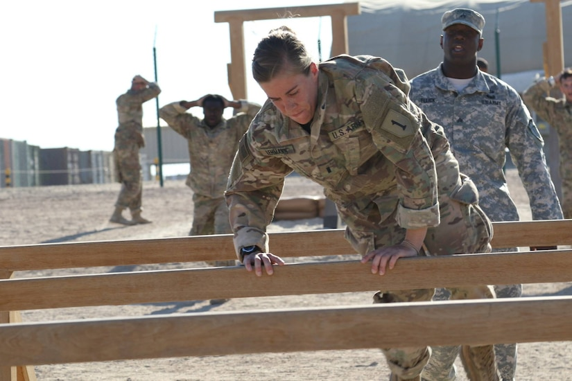 U.S. Army 1st Lt. Katlyn Lehmann (center), human resource officer, 258th Human Resource Company, navigates the six-inch vault obstacle, during day zero of U.S. Army Central's first Air Assault Course, April 4, 2017, at Camp Beuhring, Kuwait. The Air Assault Course is a 12-day class that allows U.S. military personnel in the USARCENT theater of operations the unique opportunity to become air assault qualified, while deployed outside the continental United States.