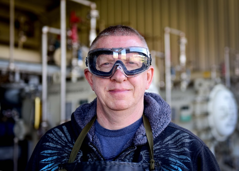 Darryl Hodge, 733rd Logistics Readiness Squadron fuels facilities fuels distribution systems operator, poses for a photo at Joint Base Langley-Eustis, Va., April 10, 2017. Fuels facilities Airmen wear an apron, gloves and googles to protect them from spills that may occur during the fuels sampling process. (U.S. Air Force photo/Staff Sgt. Areca T. Bell)