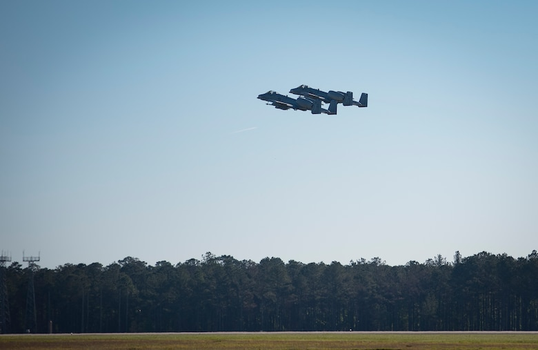 Maj. Matthew Shelly, 23 Wing director of inspections and Capt. Christopher Shelly, 76th Fighter Squadron chief of standards and evaluations, take off in A-10C Thunderbolt IIs, April 8, 2017, at Moody Air Force Base, Ga. The brothers flew in formation together for the first time, fulfilling their childhood dream while also contributing to total force integration, the use of multiple components of the Air Force, which can include active duty, reserve or guard. (U.S. Air Force photo by Airman 1st Class Lauren M. Sprunk)