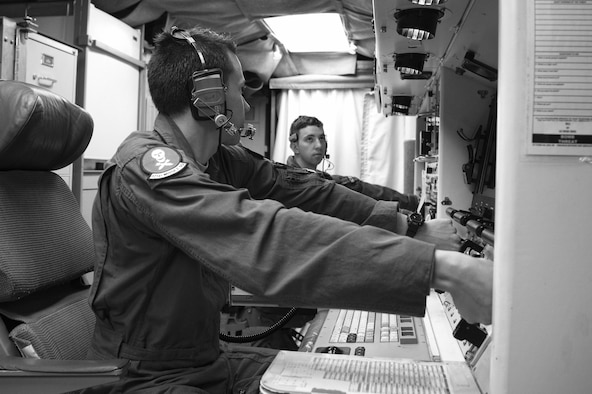 Second Lt. Chris Davis, 321st Missile Squadron deputy missile combat crew commander, and 1st Lt. Paul Lee, 321st MS missile combat crew commander, simulate key turns of the Minuteman III weapon system during a Simulated Electronic Launch-Minuteman test inside the launch control center at a missile alert facility in the 90th Missile Wing's missile complex, Neb., April 11, 2017. The 90th MW contributes to the nation's strategic defense by sustaining and operating 150 Minuteman III ICBMs and the associated launch facilities. A SELM test proves the ICBM weapon system's effectiveness in a safe and secure manner. (U.S. Air Force photo by Staff Sgt. Christopher Ruano)