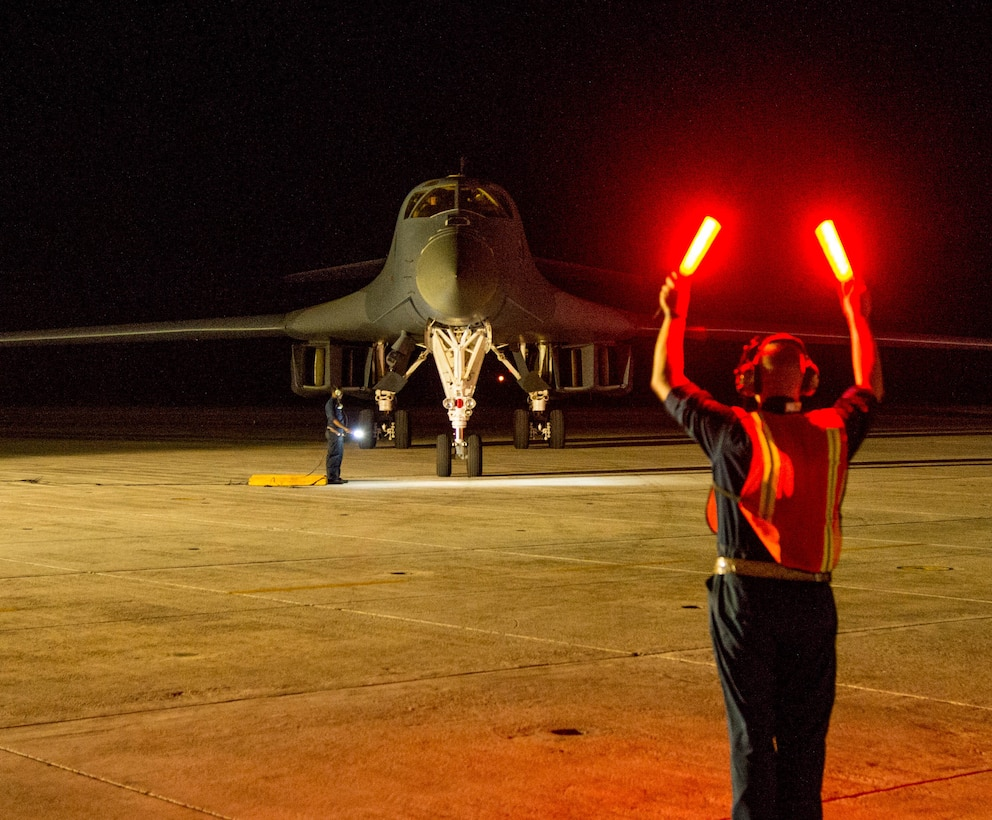 Tech. Sgt. Brian Svedin, 489th Maintenance Squadron crew chief, marshals a returning B-1 Lancer at the Boca Chica Naval Air Station, Key West Fla., flightline after its role in the Joint Interagency Task Force South mission March 23, 2017. Airmen from the 489th Bombardment Group and the 7th Bomb Wing supported the Drug Enforcement Agency, FBI, Coast Guard and other government agencies in the fight against illicit drugs. (U.S. Air Force photo by Staff Sgt. Jason McCasland/released)