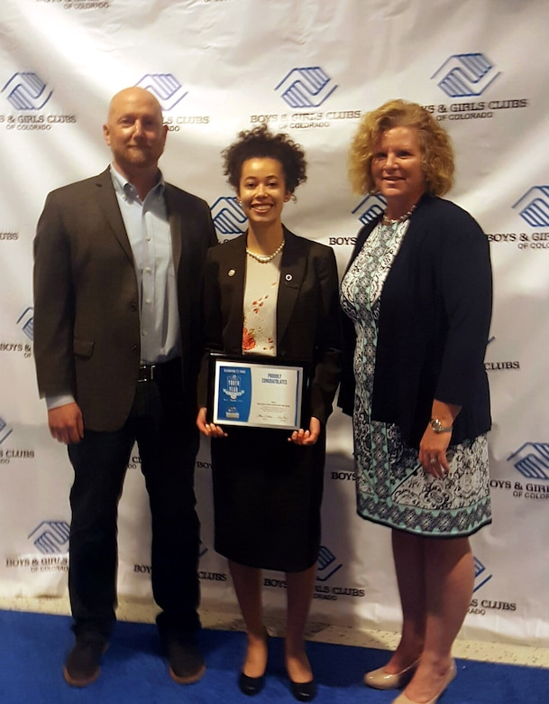 Danielle Wright, Colorado Military Youth of the Year, poses between Vincent Kurtz, 460th Force Support Squadron team coordinator, and Kaureen Whittaker, 460th FSS youth programs chief, March 28, 2017, at the National Youth of the Year Celebration in Denver. Youth of the Year is a national Boys & Girls Club program, and was established to recognize and honor the nation's most inspirational teens. (Courtesy photo)