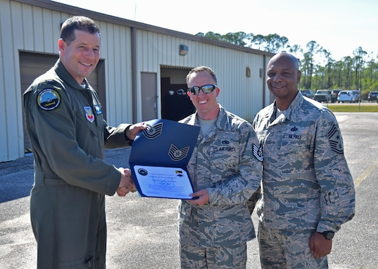 Col. Michael Hernandez, 325th Fighter Wing commander, and Chief Master Sgt. Craig Williams, 325th FW command chief, congratulate Tech. Sgt. Evan Oehlbeck, 325th Maintenance Squadron munitions control supervisor, on being promoted by the Stripes for Exceptional Performers program April 11, 2017 at Tyndall Air Force Base, Fla. The STEP program supplements the existing airmen promotion program and is designed to accommodate unique circumstances that, in the commander's judgment, clearly warrant promotion. (U.S. Air Force photo by Senior Airman Sergio A. Gamboa/Released)