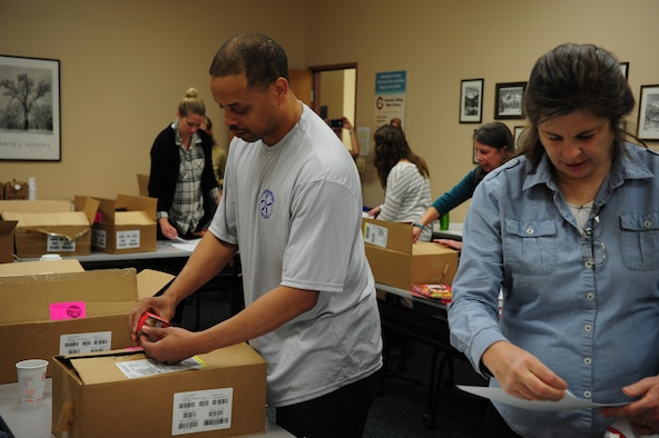 Members of Team Buckley's Diversity Council assist with the sorting and packing of boxes to be shipped to children for One Book 4 Colorado, March 29, 2017 at Buckley Air Force Base, Colo. One Book 4 Colorado is a collaboration with the lieutenant governor's office to promote early literacy by providing 75,000 copies of the same book in English and Spanish to four-year-old children across the state. (Courtesy photo)