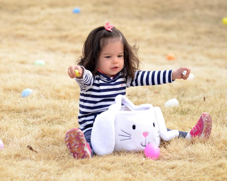 A child displays her loot at last year's Easter egg hunt. Kirtland is offering three separate egg hunts this year, including a new event  call Eggtastic Splash & Dive at the indoor pool.