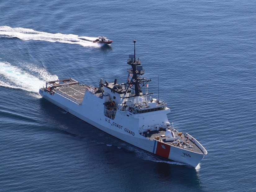 Crewmembers aboard the Coast Guard Cutter Munro, a 418-foot National Security Cutter, and its small boat transit the Gulf of Mexico on Feb. 12, 2017. National Security Cutters are sophisticated platforms and allow crews to protect our borders, supporting national security and prosperity. U.S. Coast Guard photo by Seaman Courtney Fussell.