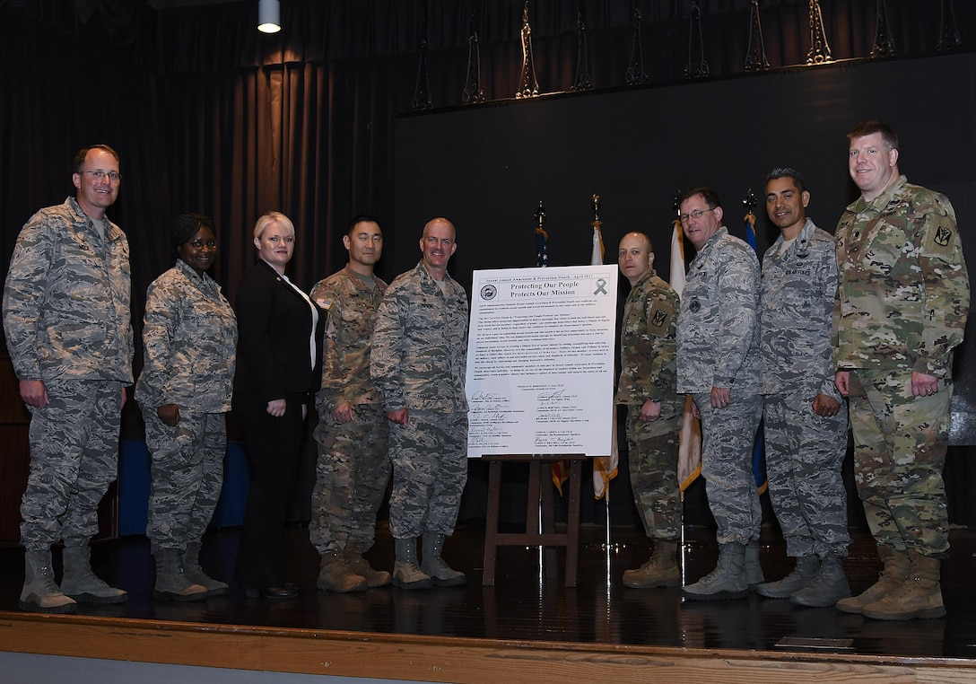 Commanders from Team Osan stand by their signed pledge to take responsibility for their special roles in preventing sexual assault amongst personnel under their command during the Sexual Assault Awareness and Prevention Month Kick-off Breakfast at Osan Air Base, Republic of Korea, April 11, 2017. The pledge recognizes that command teams are a key instrument in creating a sexual-violence free climate. (U.S. Air Force photo by Airman 1st Class Gwendalyn Smith)