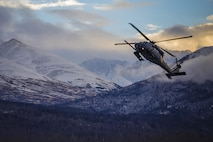 "In this file photo, an HH-60 Pave Hawk helicopter from the 210th Rescue Squadron, Alaska Air National Guard, practices ""touch and go"" maneuvers at Bryant Army Airfield on Joint Base Elmendorf-Richardson, Dec. 17, 2014. (U.S. National Guard photo by Sgt. Edward Eagerton)"