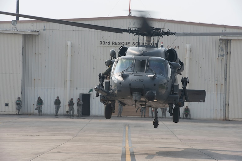A 33rd Rescue Squadron HH-60 Pave Hawk takes off to conduct training operations during a no-notice exercise April 12, 2017, at Kadena Air Base, Japan. The 18th Wing is capable of rapidly generating combat ready aircraft and support at a moment's notice, and exercises keep members of Team Kadena ready around the clock to defend Okinawa from threats. (U.S. Air Force photo by Senior Airman John Linzmeier)