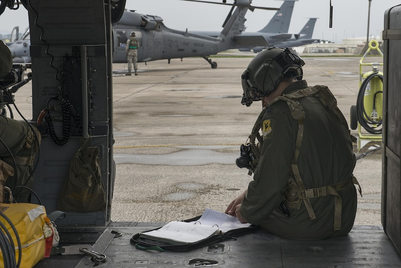 A U.S. Air Force Airman with the 33rd Rescue Squadron inspects a log during a training exercise April 12, 2017, at Kadena Air Base, Japan. Exercises keep members of Team Kadena ready for any situation in the defense of Japan and U.S. interests throughout the Indo-Asia Pacific Theater. (U.S. Air Force photo by Senior Airman John Linzmeier)