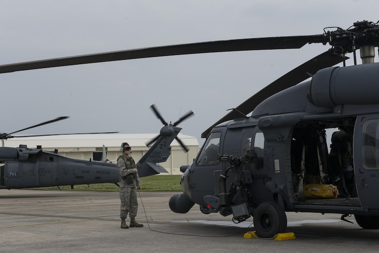 A U.S. Air Force Airman runs through pre-flight procedures of a 33rd Rescue Squadron HH-60 Pave Hawk during a training exercise April 12, 2017, at Kadena Air Base, Japan. Maintaining operational readiness is essential for the 18th Wing to be able to respond to any natural disaster or adversarial threat in the region. (U.S. Air Force photo by Senior Airman John Linzmeier)