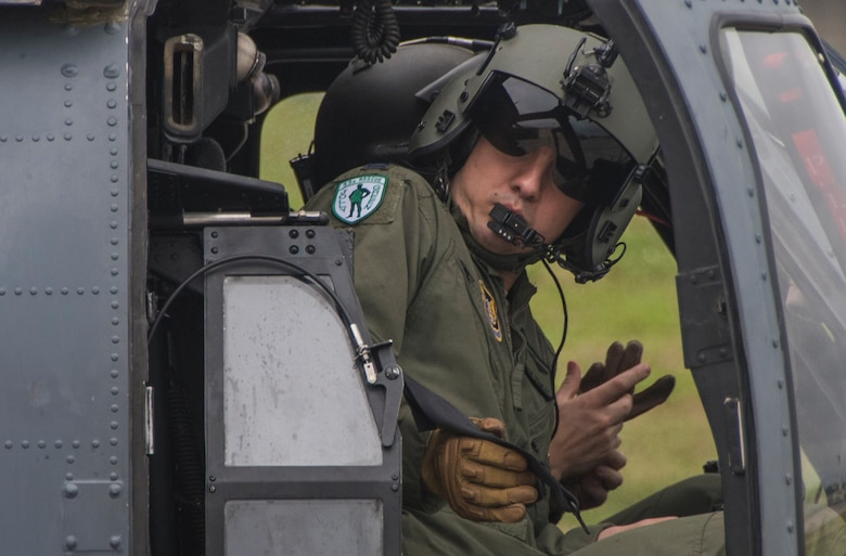 A pilot with the 33rd Rescue Squadron buckles into an HH-60 Pave Hawk during a training sortie April 11, 2017, at Kadena Air Base, Japan. The 18th Wing maintains constant mission readiness, to enhance peace and security in the Pacific and defense of U.S. and allied and interests throughout the Indo-Asia Pacific Theater. (U.S. Air Force photo by Senior Airman John Linzmeier)