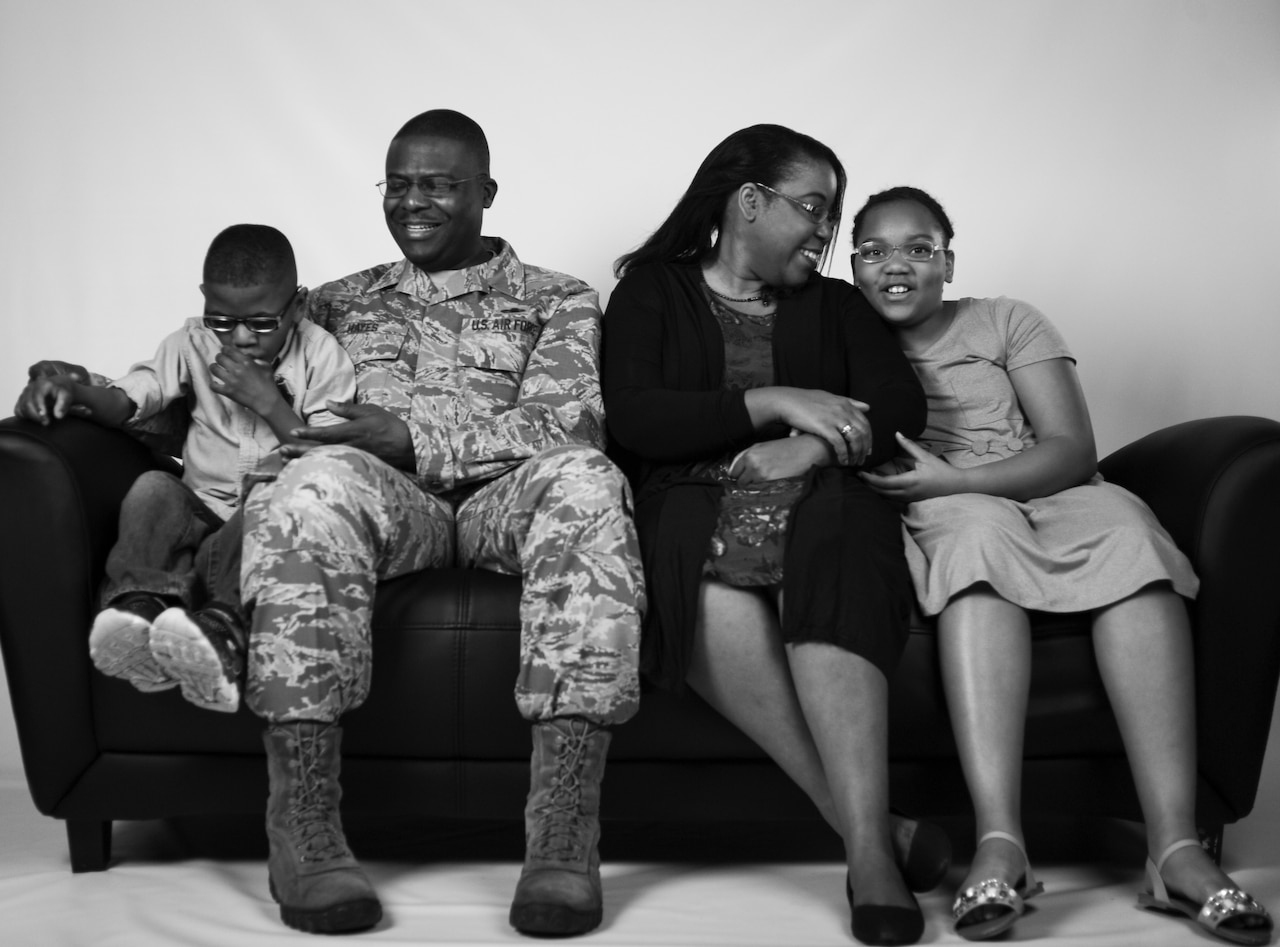 U.S. Air Force Chief Master Sgt. Henry Hayes, Air Combat Command first sergeant, poses for a photo with his family at Joint Base Langley-Eustis, Va., March 27, 2017. Hayes and his wife, Stephanie, provide foster care for children, which led them to the adoption of two of their children. (U.S. Air Force photo/Staff Sgt. Natasha Stannard)