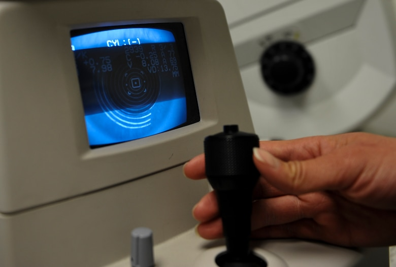 U.S. Air Force Senior Airman Kiara Warren, 51st Aerospace Medicine Squadron optometry technician, operates the auto refractometer machine at Kunsan Air Base, Republic of Korea, March 24, 2017. The auto refractometer measures the curvature of the eye and allows a scan to give a baseline prescription for eyes. (U.S. Air Force photo by Senior Airman Colville McFee/Released)