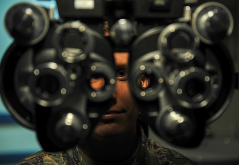 U.S. Air Force Staff Sgt. River Carson, 8th Medical Operations Squadron public health technician, stares through the phoropter at a letter chart during his eye exam at Kunsan Air Base, Republic of Korea, March 24, 2017. The phoropter checks for refractive errors in the eyes and assists in eye glass prescriptions.  (U.S. Air Force photo by Senior Airman Colville McFee/Released)