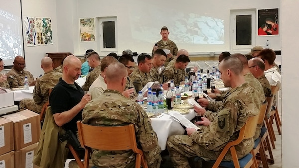 Service members observe the 2016 Passover holiday at Bagram Airfield, Afghanistan. DLA Troop Support provided 223 Seder kits, which contain matzah, a shank bone and other religious items, for Jewish service members who celebrate the eight-day festival of Passover.