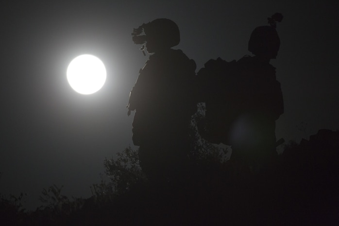 U.S. Marine Corps Capt. David Hirt, left, AH-1 instructor and Maj. Stephen Piantarnida, AH-1 instructor with Marine Aviation Weapons and Tactics Squadron One observe the terrain using night vision goggles during offensive air support exercise 5 in support of Weapons and Tactics Instructor course 2-17 at Chocolate Mountain Aerial Gunnery Range, Arizona, April 11, 2017. OAS is designed to focus on the integration of all air combat element aviation assets with a developed ground scheme of maneuver to conduct close air support. WTI is a seven-week training event hosted by MAWTS-1 cadre, which emphasizes operational integration of the six functions of Marine Corps aviation in support of a Marine Air Ground Task Force and provides standardized advanced tactical training and certification of unit instructor qualifications to support Marine Aviation Training and Readiness and assists in developing and employing aviation weapons and tactics.