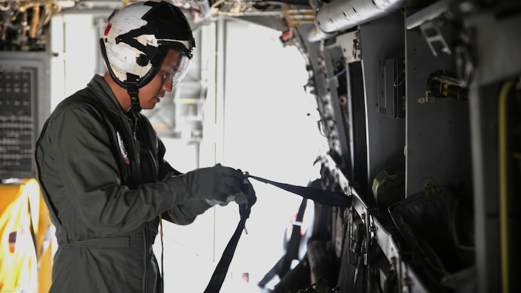 Sgt. 1st Class Midsru Miyazaki conducts pre-flight checks on the MV-22 Osprey before a flight aboard Marine Corps Air Station New River, N.C., April 7, 2017. Before every flight, it is the crew chief's responsibility to check all safety and mechanical systems to ensure the safety of all the members on the flight. Miyazaki has been training to become the first Japanese MV-22 Osprey crew chief. VMMT-204 is assigned to Marine Aircraft Group 26, 2nd Marine Aircraft Wing.