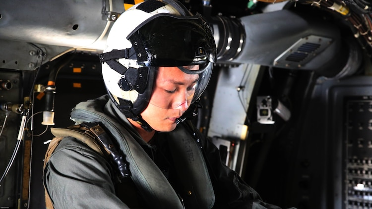 Sgt. 1st Class Midsru Miyazaki puts on his gear before a flight at Marine Corps Air Station New River, N.C., April 7, 2017. Miyazaki is currently training with VMMT-204 where he works closely with Marines in order to learn the skills necessary to become a crew chief. His gear consists of his helmet with built in communication system and eye protection, a flack and a life preserver. VMMT-204 is assigned to Marine Aircraft Group 26, 2nd Marine Aircraft Wing.