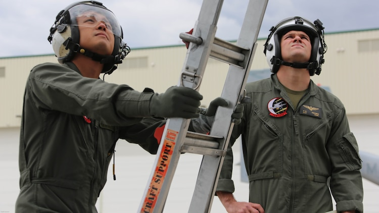 Sgt. 1st Class Midsru Miyazaki, left, and 1st Lt. Hunter Trotman, right, observe a Marine maintaining a MV-22 Osprey engine at Marine Corps Air Station New River, N.C., April 7, 2017. Miyazaki is training to become the first Japanese crew chief of a MV-22 Osprey. Before every flight the crew chief has to check all mechanical systems both inside and outside the aircraft to ensure proper safety of crew. Trotman is a MV-22 Osprey pilot in training assigned to VMMT-204. VMMT-204 is assigned to Marine Aircraft Group 26, 2nd Marine Aircraft Wing.