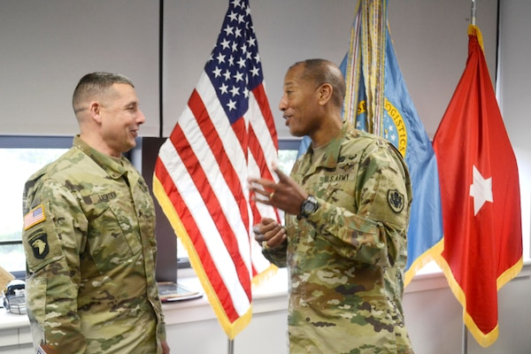 DLA Troop Support Commander Army Brig. Gen. Charles Hamilton, right, and DLA Distribution Commander Army Brig. Gen. John Laskodi, left, meet during Laskodi's visit to DLA Troop Support April 7, 2017 in Philadelphia. During a round table discussion, Laskodi, DLA Distribution representatives and DLA Troop Support senior leaders discussed collaboration and mutual goals of the two DLA primary field level activities.