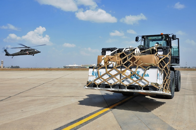 Airman 1st Class Carlos Tubbs, a 442nd Air Expeditionary Squadron aircraft services specialist, unloads a pallet of cargo off of a Marine C-130 March 21, 2017, at the Baghdad Diplomatic Support Center, Iraq.  Tubbs loads and unloads cargo supporting Combined Joint Task Force – Operation Inherent Resolve missions. (U.S. Air Force photo/Tech. Sgt. Kenneth McCann)