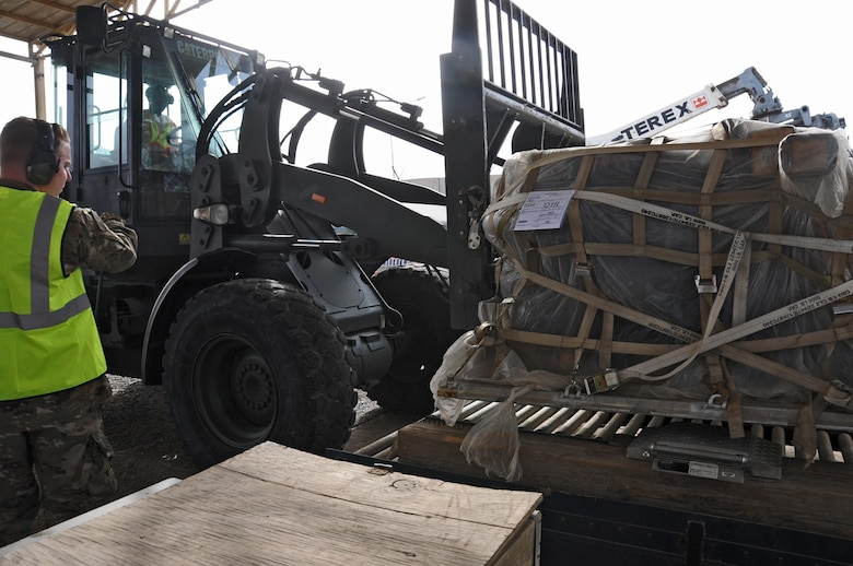 Senior Airman Matthew Anderson and Airman 1st Class Carlos Tubbs, 442nd Air Expeditionary Squadron aircraft services specialists, weigh a pallet of cargo March 21, 2017, at the Baghdad Diplomatic Support Center, Iraq. Aerial Porters are responsible for transporting cargo in and out of the BDSC in support of Combined Joint task Force - Operation Inherent Resolve. (U.S. Air Force photo/Tech. Sgt. Kenneth McCann)