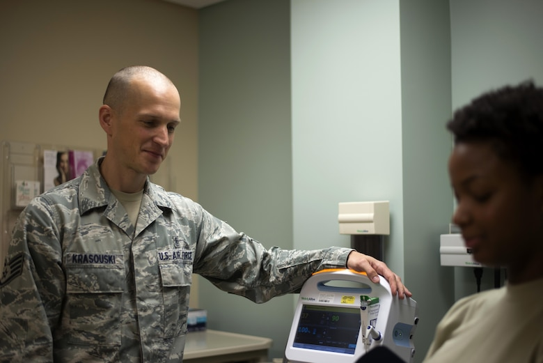 U.S. Air Force Staff Sgt. Aliaksei Krasouski, a medical technician assigned to the 91st Air Refueling Squadron, prepares to check the vitals of a patient March 8, 2017, at MacDill Air Force Base, Fla. Krasouski served in the Belarussian Air Force before coming to the U.S. 10 years ago. (U.S. Air Force Photo by Airman 1st Class Rito Smith)