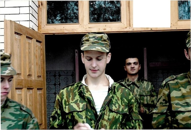 Aliaksei Krasouski, center, stands with fellow Belarussian airmen in August 2004 during his time in the Belarussian Air Force. Before coming to the U.S. and becoming a medical technician in the U.S. Air Force, Krasouski lived in Minsk, Belarus and served in the Belarussian Air Force. (Courtesy Photo)