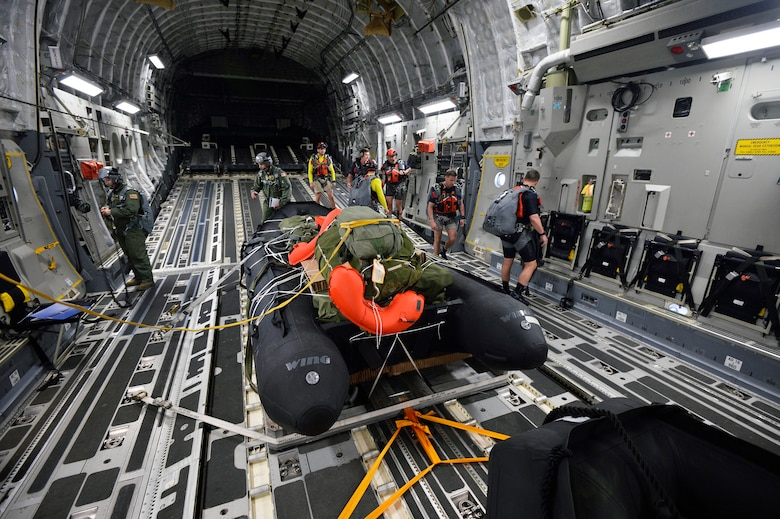 NewYork Air National Guard pararescuemen and Combat Rescue Officers assigned to the 103rd Rescue Squadron of the 106th Rescue Wing prepare to drop a preloaded inflatible boat from a C-17 flown by the Hawaii Air National Guard's 204th Airlift Squadron of the 154th Wing into the waters off Joint Base Pearl Harbor- Hickam on March 6, 2017. This training was conducted alongside NASA personnel at Joint Base Pearl Harbor-Hickam, Hawaii during Exercise SENTRY ALOHA March 6, 2017. A major element of this two week TDY is to participate in a joint NASA and Defense Department mission to evaluate recovery techniques and gear that will be used to recover NASA's Orion spacecraft, the next generation of American space vehicle. US Air National Guard Photo by Staff Sgt. Christopher S. Muncy