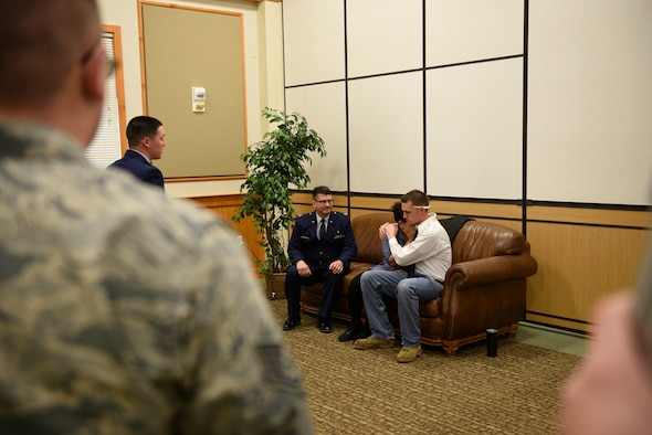 """Senior Airman Annastasia Bostic, mother of the victim, is consoled by Tech. Sgt. Dustin Haldane, father of victim, after Chaplin (Capt.) William McMullen notifies the acting parents of the death of their daughter April 12, 2017, at the Grizzly Bend at Malmstrom Air Force Base, Mont. The event was part of """"Live or Die,"""" a production helping members think about consequences before they get behind the wheel intoxicated. (U.S. Air Force photo\ Staff Sgt. Lindsey Soulsby)"""