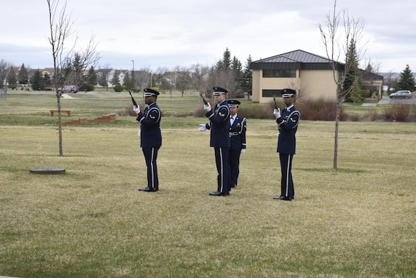 """Malmstrom Honor Guard members render a 21 gun salute during a simulated funeral April 12, 2017, at Malmstrom Air Force Base, Mont. The event was part of """"Live or Die,"""" a production helping members think about consequences before they get behind the wheel intoxicated. (U.S. Air Force photo\ Staff Sgt. Lindsey Soulsby)"""