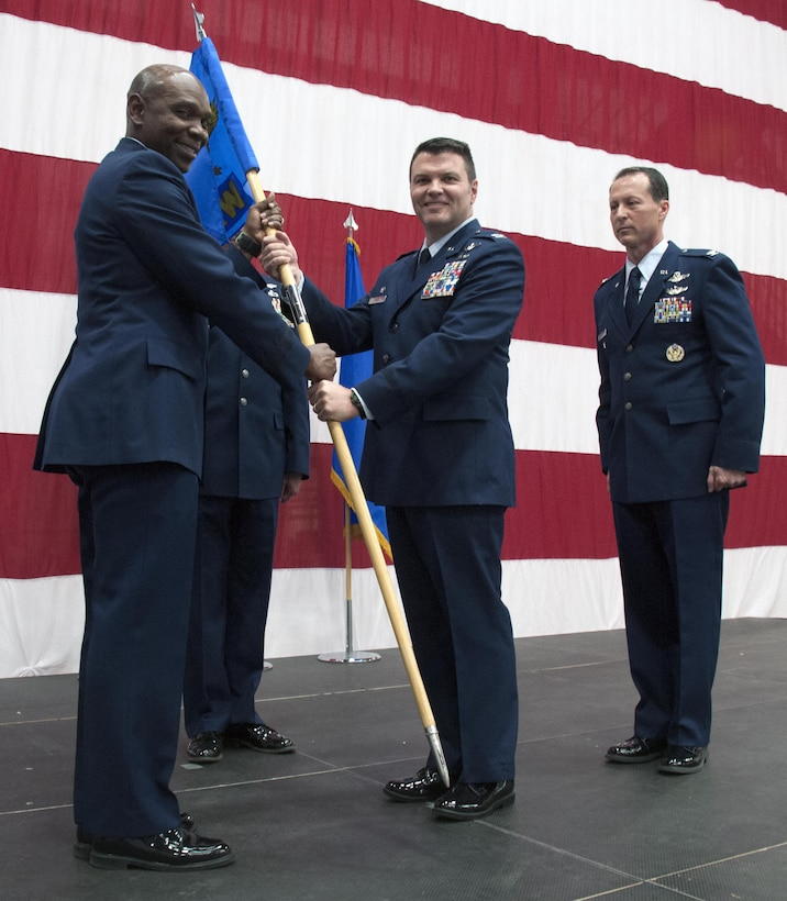 Brig. Gen. Ondra Berry, the Asst. Adjutant General of Nevada Air National Guard, Reno, Nev. passes the flag, and command, of the 152nd Airlift Wing to the new commander, Col. Eric Wade. Col. Karl Stark (far right), the outgoing commander relinquished command of the 152nd Airlift Wing on April 1, 2017.