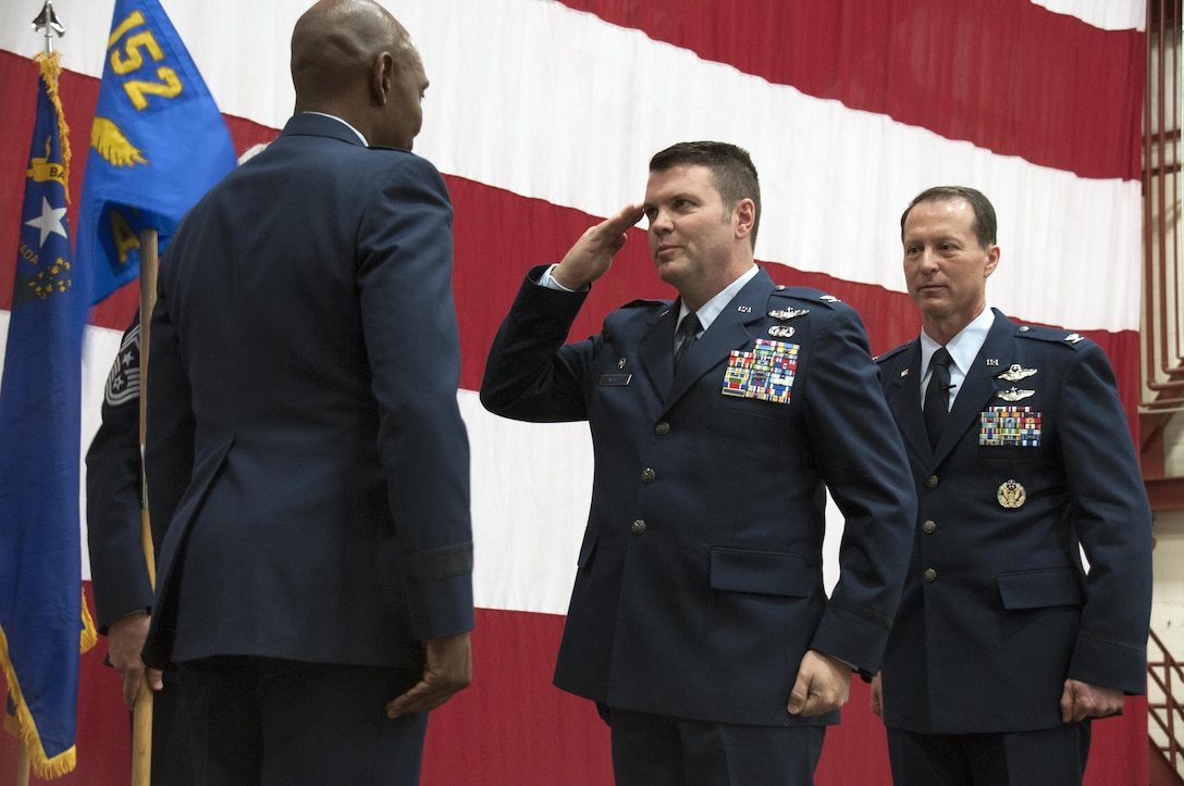 Col. Eric Wade, the incoming commander of the 152nd Airlift Wing in Reno, Nev., salutes Brig. Gen. Ondra Berry, the Assistant Adjutant General of Nevada Air National Guard during the Change of Command Ceremony. Col. Karl Stark (far right), the outgoing commander, relinquished command on April 1 this year.