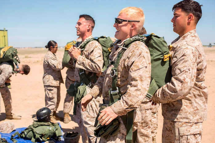 U.S. Marine Cpl. Joseph Kennard assists Lance Cpl. Chancy Rogers with adjusting his parachute during Weapons and Tactics Instructors Course 2-17 on Marine Corps Air Station, Yuma, Ariz., March 30, 2017. Static line parachute training is used to develop Marines' efficiency with the equipment. Kennard is an air delivery specialist with Landing Support Company, 1st Transportation Support Battalion, Combat Logistics Regiment 1, 1st Marine Logistics Group and Rogers is an air delivery specialist with Landing Support Company, 2nd TSB, CLR-2, 2nd MLG. (U.S. Marine Corps photo by Lance Cpl. Roderick Jacquote)